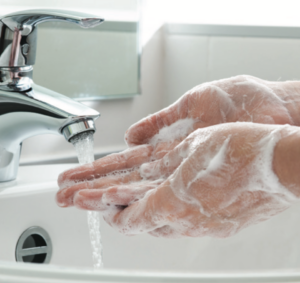 Washing hands with soap and water to kill COVID-19 coronavirus and other viruses and germs